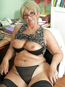 Older mistress in hot clothes