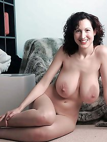 Tattooed mature gilfs posing undressed for a photoshoot