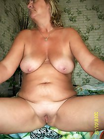 Skinny MILF with unshaved slit