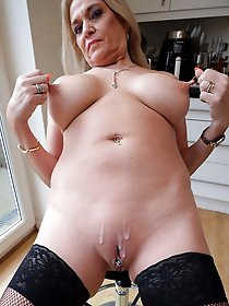 Mature babe playing alone
