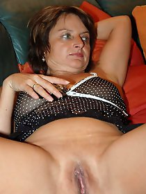 Libidinous mature mistress playing with her hooters