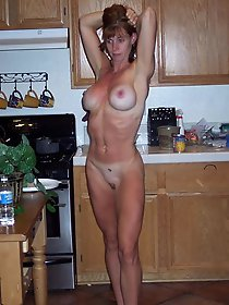 Amazing old businesswoman posing totally undressed